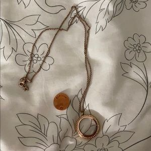 Rose gold origami owl necklace.